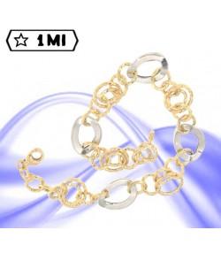 Bracciale anelli martellati in oro giallo e ovali in oro bianco