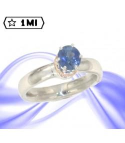 Elegante solitario in platino con zaffiro blu e diamanti