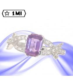 Elegante anello in oro bianco con zaffiro rosa e diamanti